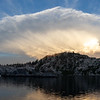 Storm Cloud Explosion Over Mountain Lake