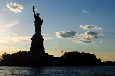 Statue of Liberty from  Circle Cruise Tour at sunset in June 2010.