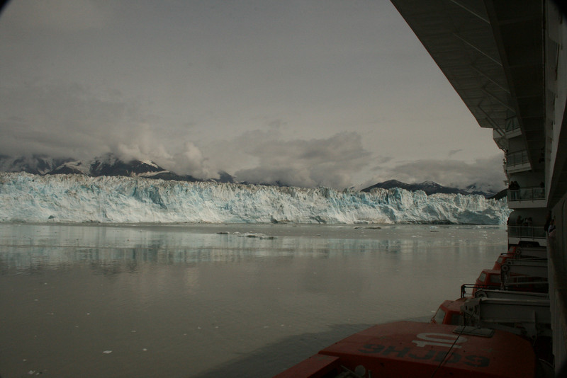 Captain turns both sides of ship to glacier, and on our side, we rush to cabin balcony to get a view.