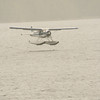 Later in day, after stuffing ourselves with crab at old lodge, our seaplane lands to take us back to ship . . .