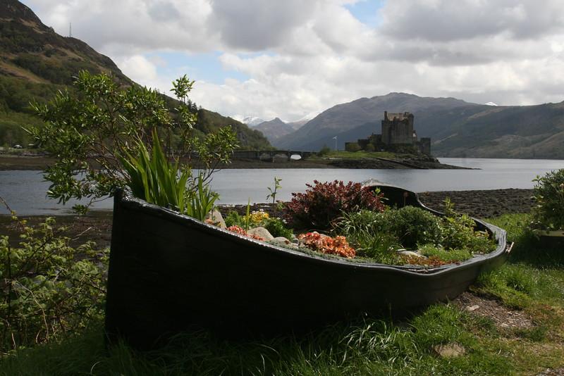 Eileen Donan Castle in the background.  Marvelous garden arrangment in foreground.  Located in the Dornie area, near Kyle of Lochalsh.
