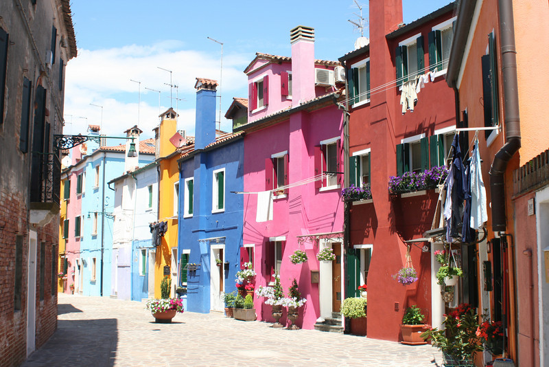 Near Venice are a couple of neat islands.  One of them, Murano - famous for glass factories, we did not visit.  We did visit Burano - famous for lace production, but also incredibly beautiful and full of character.  Colorful houses and building all over the island!!