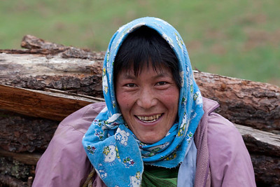 It's 6 AM and she's carrying a large heavy load of wood down the hillside to the village already.  She's smiling because I was an excuse to stop and rest.