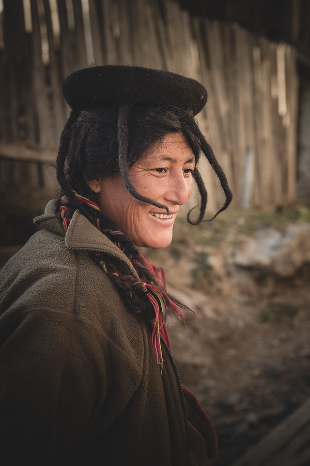 bhutanese woman in traditional headress.