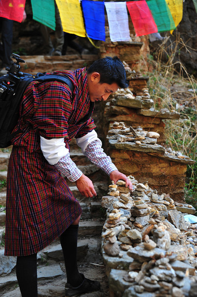 Namgay stopping to build stone stupas on the way