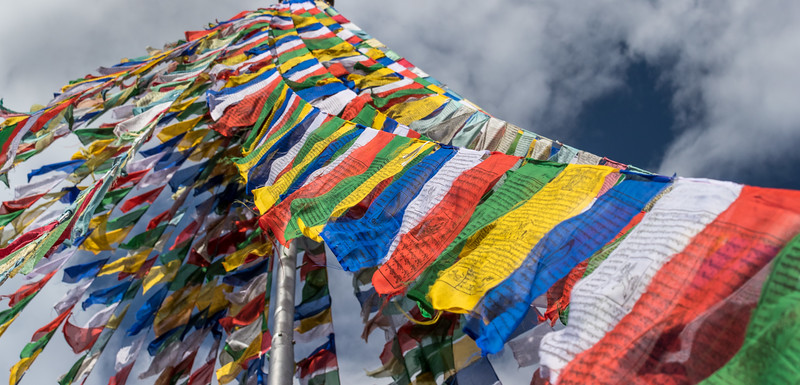 "Chhimi Lhakhang Monastery, Bhutan. An array of prayer flags towers over this ""Monastery of the Divine Madman,"" which was named after maverick saint Lama Kunley, who blessed the site in the 15th century."
