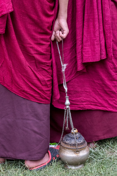 Kurjey Tshechu, Bumthang, Bhutan. As the tshechu wraps up, a monk pauses with an incense urn.