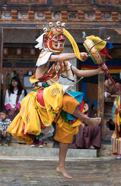 Nimalung Tshechu, Bumthang, Bhutan. In the Drummers from Drametse dance, twelve men wearing animal masks beat handheld drums as they dance. This dance originated in the Drametse Monastery in eastern Bhutan.