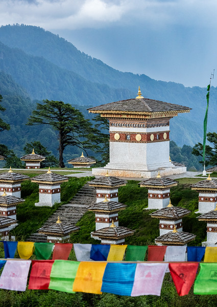 Dochula Pass, Bhutan. These are a few of the 108 memorial chortens that were built at this 10,200 foot (3,100 meter) pass to honor the Bhutanese soldiers who were killed in a 2003 battle to expel Indian insurgents. The insurgents were using bases in southern Bhutan to attack across the border into India.