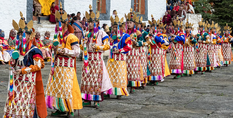 Kurjey Tshechu, Bumthang, Bhutan. The Dance of the Sixteen Fairies (Rigma Chudrug). The aprons of the dancers are made of ornamental carvings from yak bones, linked together.