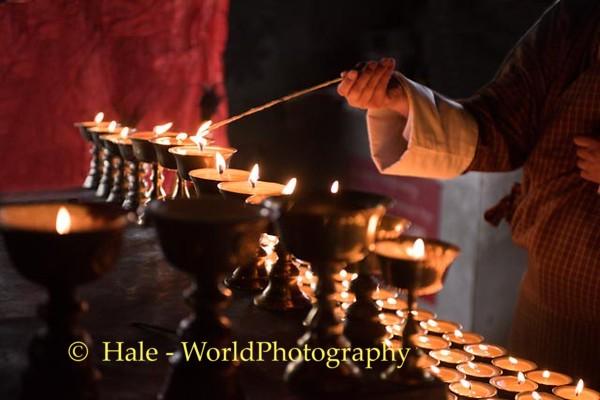 Lighting Butter Lamp at Kori La Pass, Bhutan