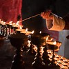 Lighting Butter Lamp at Kori La Pass, Bhutan