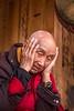Monk Applies Sunscreen