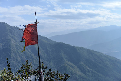 Prayer flag over Paro Valley, Bhutan nature by Jens Kirkeby