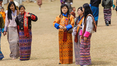 March - Young women in galla kiras at Paro Tshechu