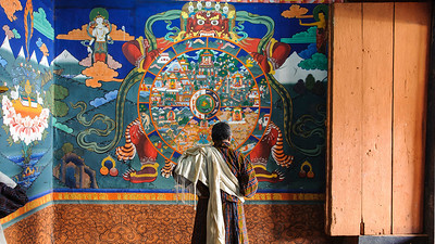 The Wheel of Life at the gate to Paro Dzong courtyard.