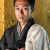 Tashi with traditional Bhutanese communication device