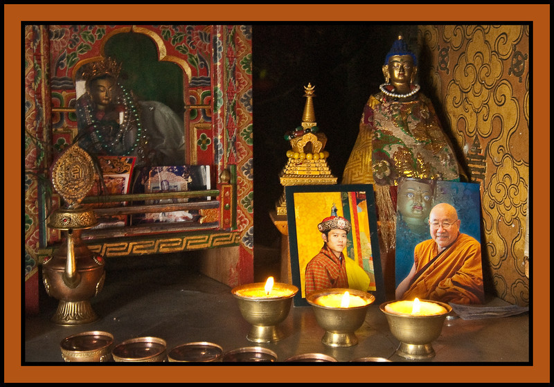 "The King and the Dalai Lama.  Taktshang, ""The Tiger's Nest,"" a Tibetan Buddhist hermitage perched on a small cliff-side ledge 3,100 feet above the floor of the Paro Valley."