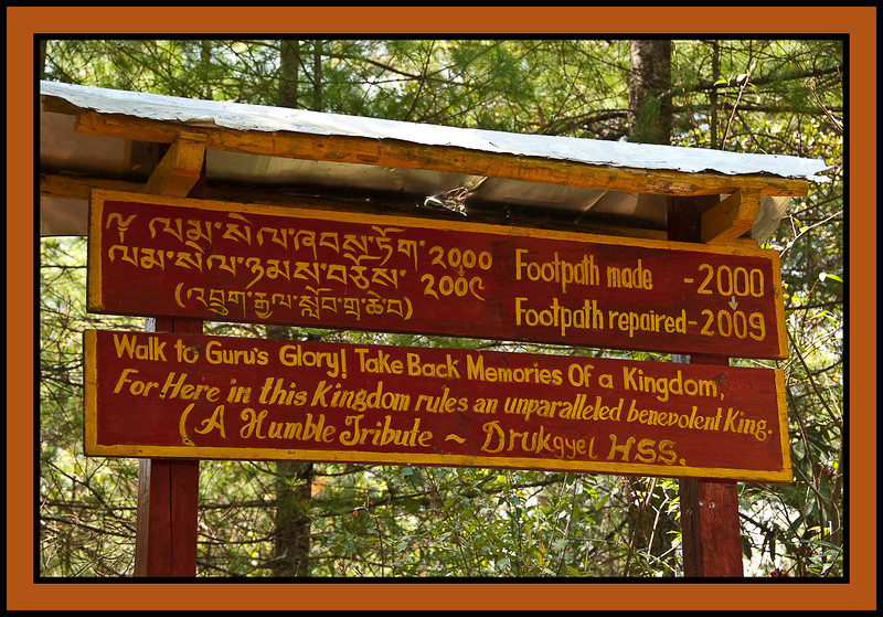"""Taktshang, """"The Tiger's Nest,"""" a Tibetan Buddhist hermitage perched on a small cliff-side ledge 3,100 feet above the floor of the Paro Valley.  According to legend, the  great Tibetan saint Guru Rinpoche (Padmasambhava) landed on this ledge after flying across the Himalaya on  the back of a tiger."""