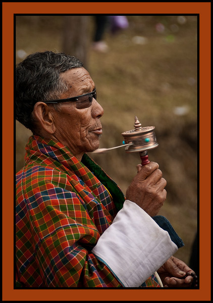 Man twirling prayer wheel, Chukhha Festival, Bhutan
