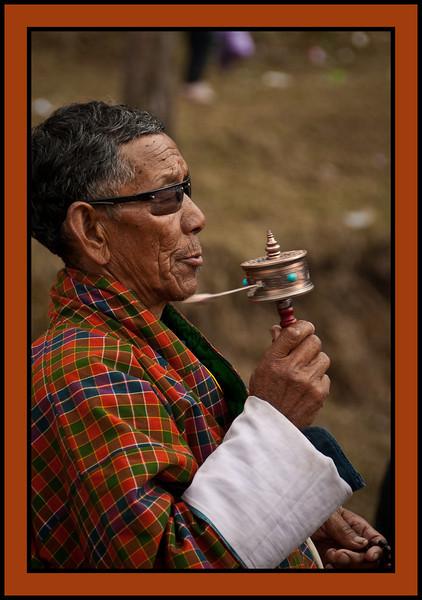 Man twirling prayer wheel, Chukhha Festival, Bhutan