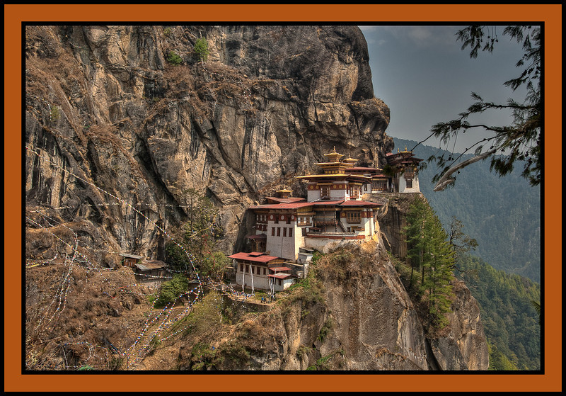 "Taktshang, ""The Tiger's Nest,"" a Tibetan Buddhist hermitage perched on a small cliff-side ledge 3,100 feet above the floor of the Paro Valley.  According to legend, the  great Tibetan saint Guru Rinpoche (Padmasambhava) landed on this ledge after flying across the Himalaya on  the back of a tiger."