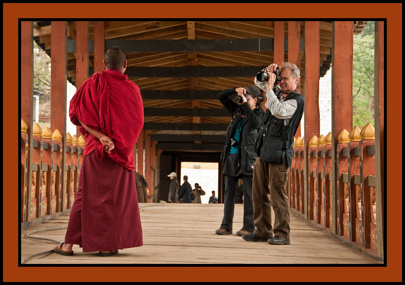 Monk being photograhed by Victoria and Brad Stamm - Punakha Dzong - massive fortress/monastery constructed in the mid-1600s