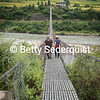 Couple Crossing Bhutan's Longest Footbridge