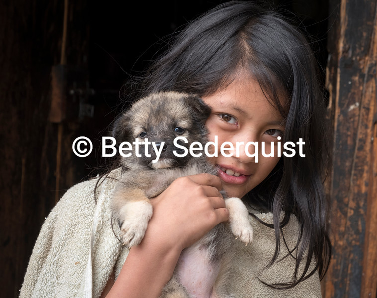 Child and Puppy at Monastery near Tiger's Nest, Bhutan