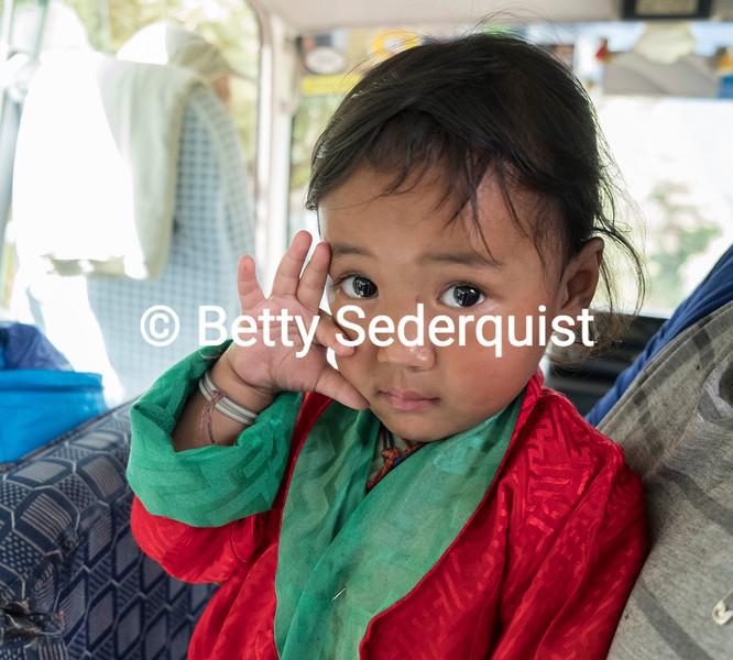 Playful Child on Bus, Bhutan