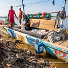 Fishermen load their boats with ice before heading out to sea to fish, Biétry-Village, Abidjan, Côte d'Ivoire