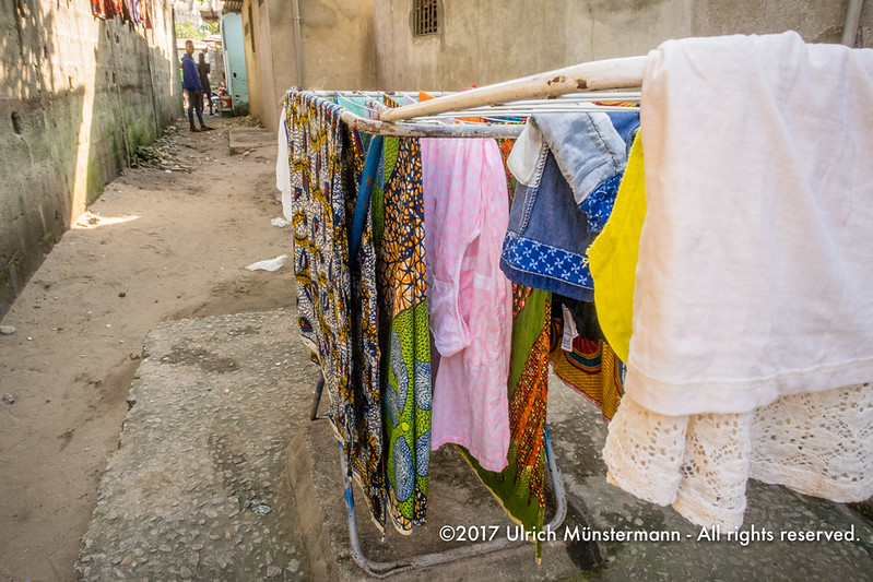 Drying clothes in the small alleys of Biétry-Village, Abidjan, Côte d'Ivoire