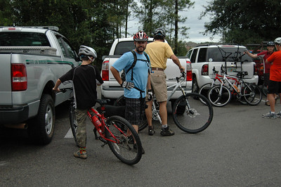 In the St. Marks Bike Trail parking lot, getting everyone geared up. Colter Foster, Jose Sanchez, Ken Foster.