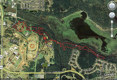 "Google Earth jpeg grab of the 2008 Tally course. From this GPS track:  http://trail.motionbased.com/trail/activity/6952119 The course is essentially unchanged from 2007. (Between the start and Conner Creek includes the major revision. Just follow the arrows, eh?) A simple pre-ride will clear up the very minor revisions. It includes Tom Brown Park's Magnolia Trail (minus the K-9 Loop's ""highside"") and BMX Track, most of West (""Lower"") Cadillac Trail, and most of the west section of Lafayette Heritage multiuse trail. All of this is located on the east side of Tallahassee. We are east of US 319, south of US 90, and north of US 27. The bodies of water visible are Weems Pond (upper left corner) and Upper Lake Lafayette (across the top)."