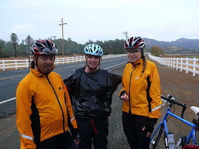 Veronica models the cyclists' traditional rainwear, while Alfie (L) and Lisa (R) model a more high visibility option.