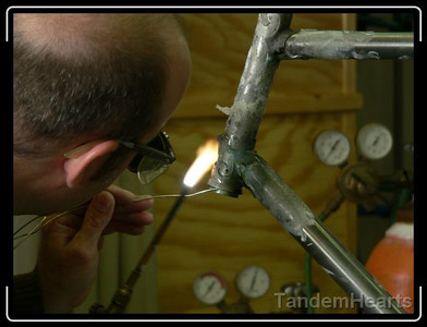 Braze from the bottom and capillary action carries the liquid metal up.