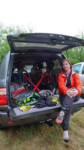 The bikes fit in the new car and Veronica tries to stay dry.