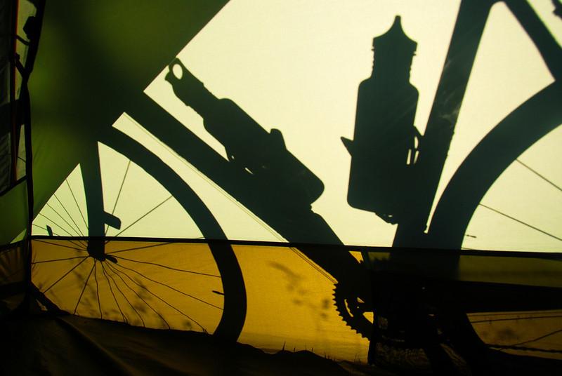 Backlit bike through tent