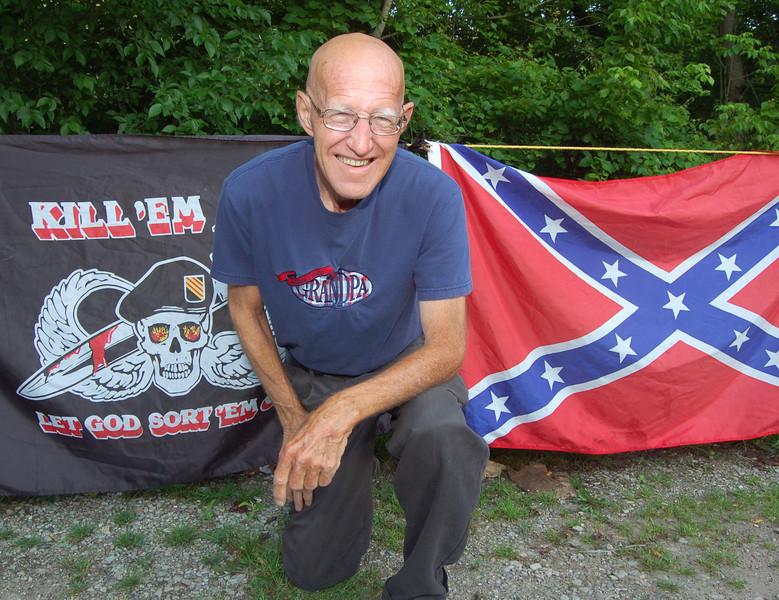A roadside flag and trinket vendor near Charleston, WV.