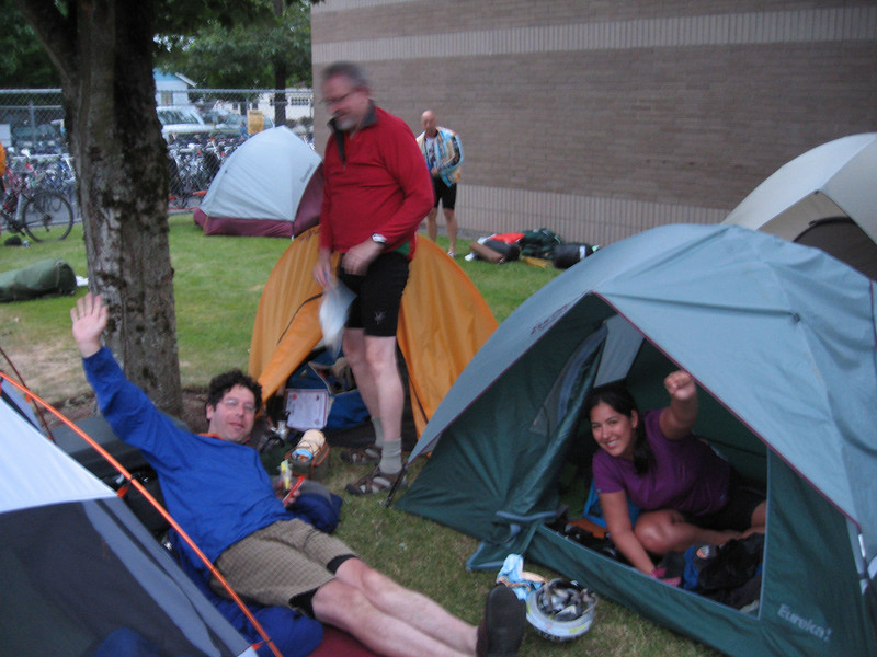 Wake-up time at 5:00 AM on day 2. Besides that we had done a century the day before and about to do another, everybody pumped to go! Rob (in red sweater) getting ready to pedal.