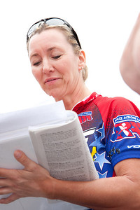 Brenda ckecks some paperwork just before the race.
