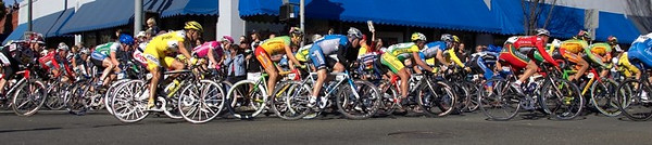Tom Danielson of Discovery and the rest of the peleton take the last corner of lap one in Stage One.