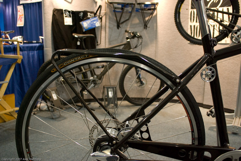 The rack is designed to blend into the tire.  No fenders.