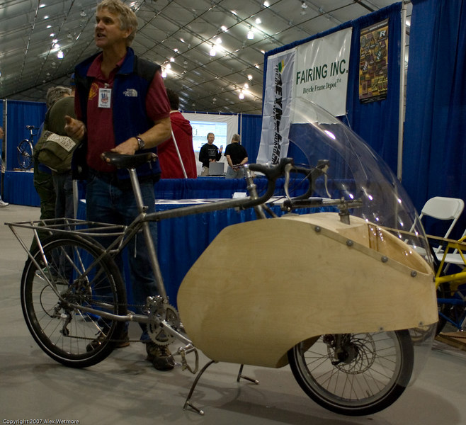 Hybrid wood/steel cargo bike.  The front fairing is structural to the bicycle and also contains a small storage area.