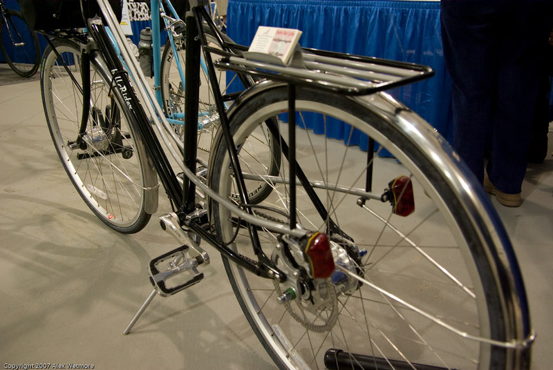 The upper tubes on the mixte curve into the bottom of the rear rack and ultimately hold the taillights.  It's a pretty design.
