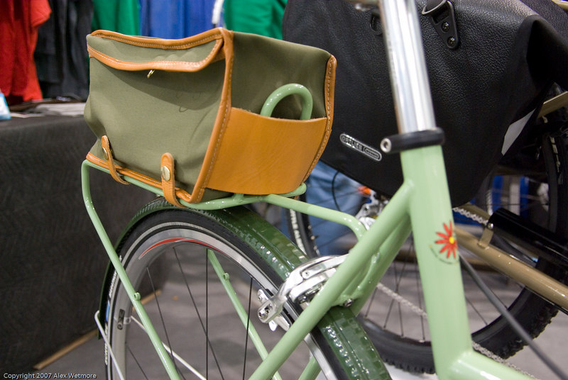 The rear rack holds this little bag but doesn't look designed for panniers.