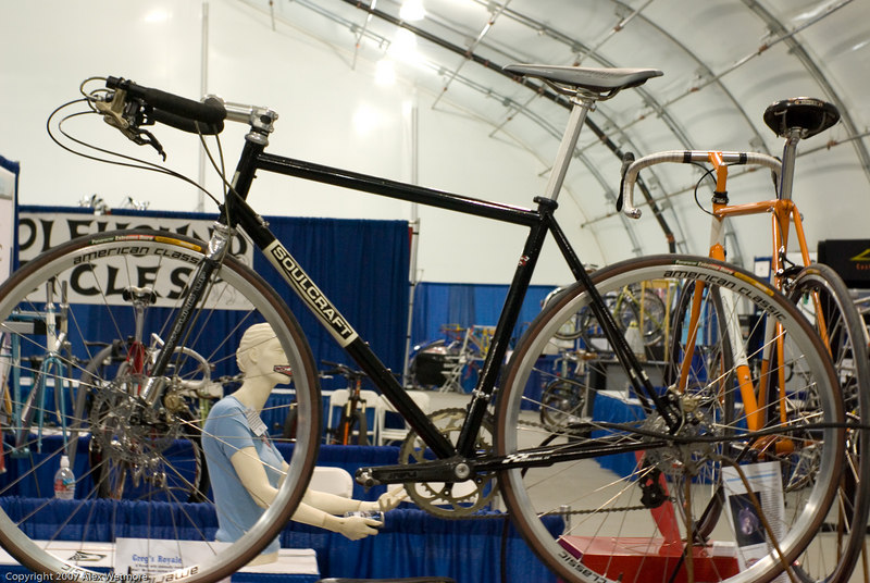 Soulcraft bike with hydraulic disk brakes, custom handlebars and shifters.  The hydraulic lines run through the frame.