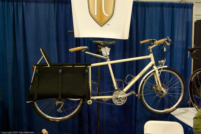 An XtraCycle like cargo bike from Fraser Cycles.  Note the small seat over the cargo area.