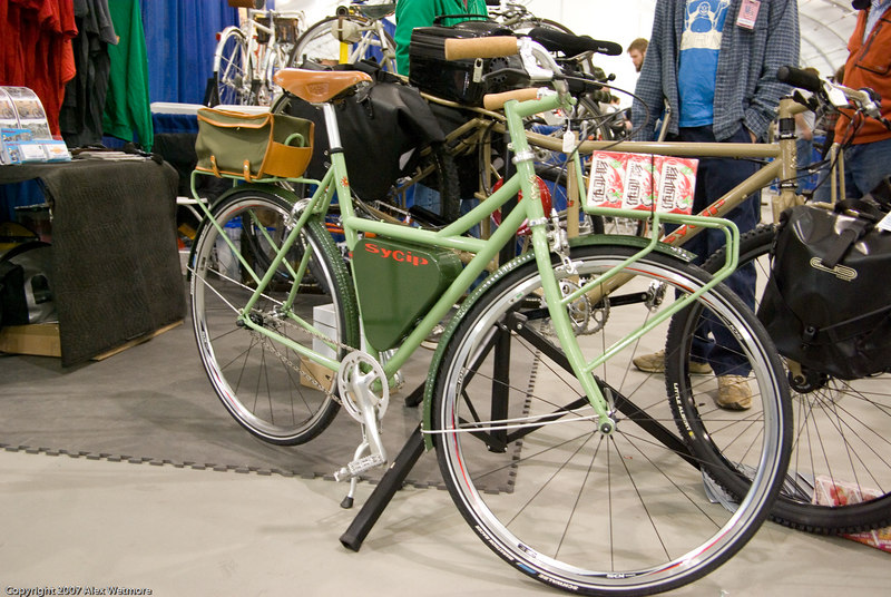 Sycip commuter singlespeed.  The front rack seems to sit farther forward than necessary.