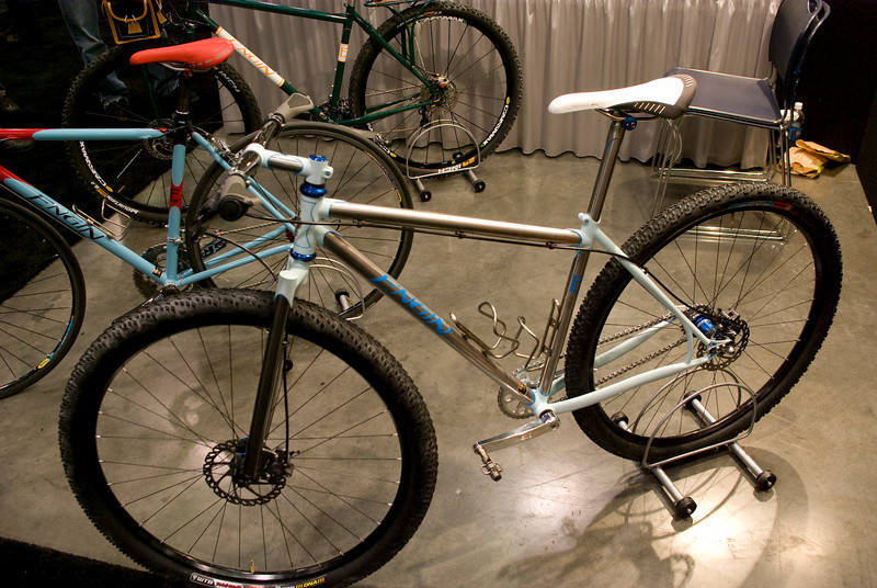 Awesome 29er singlespeed from Engin.  Custom built lugs (TIG welded together) then brazed with stainless Reynolds 953.  The fork has chromed legs.